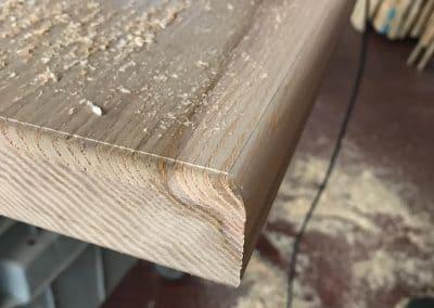 Fase lavorazione bisellatura gradini in legno