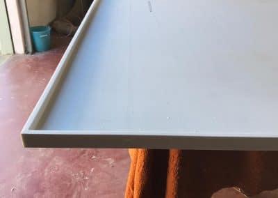 Fasi lavorazione corian per top cucina, incollaggio specchietto per ottenere 3 cm di spessore